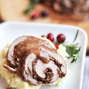 Cranberry Walnut Stuffed Pork with Brandy Sauce
