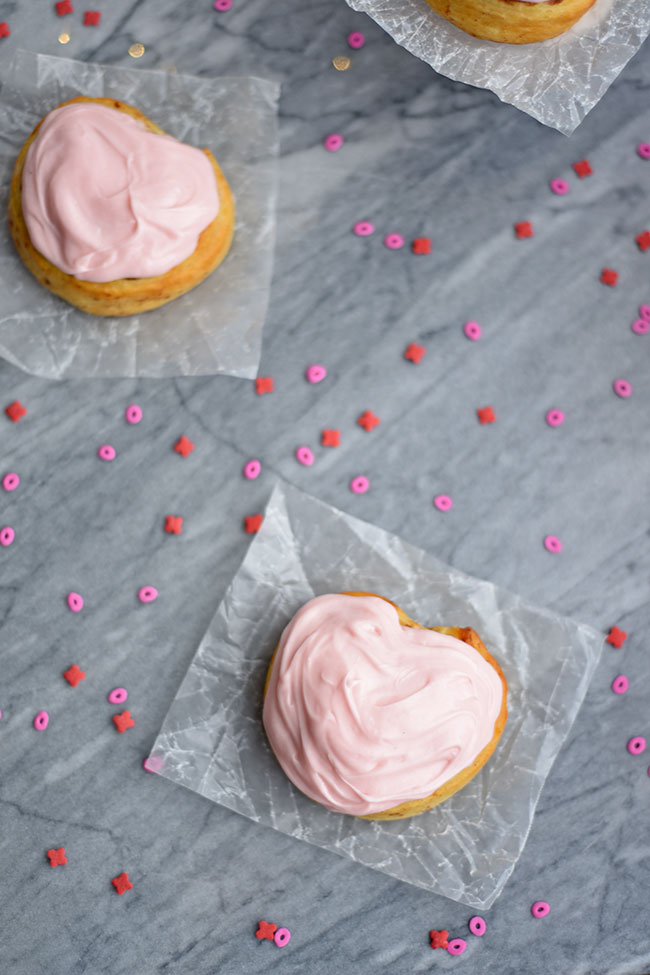 Heart-shaped Cinnamon Rolls with Cream Cheese Icing - Try these for an easy yet festive Valentine's Day breakfast!