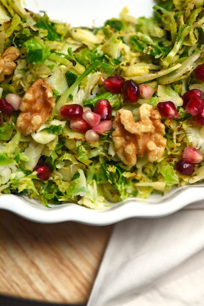 Shredded Brussels Sprouts with Pomegranate Seeds and Walnuts