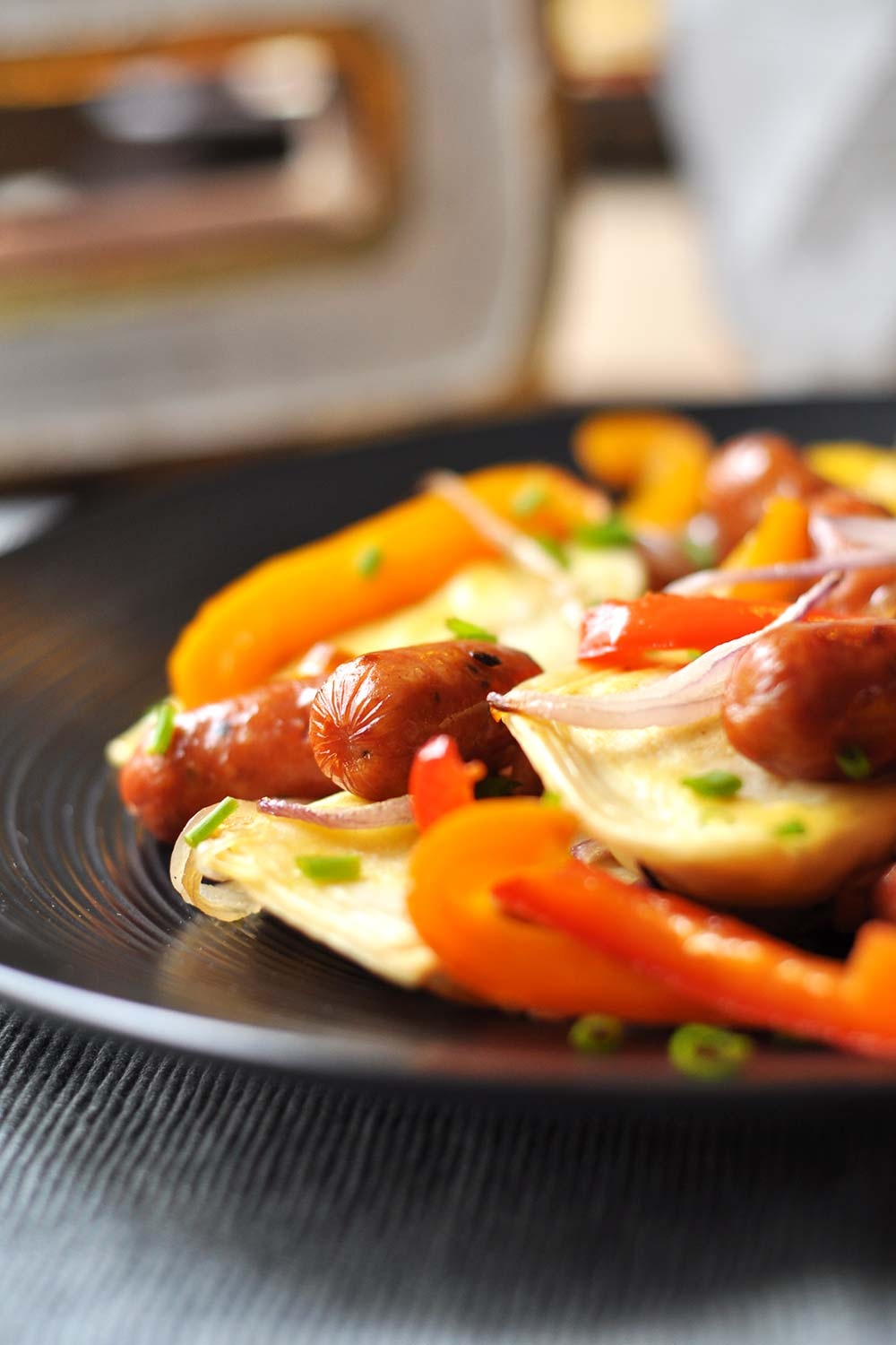 Plated Pierogies and Kielbasa with Peppers and Onions